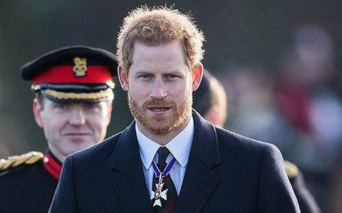 Prince Harry attends The Sovereign's Parade at Royal Military Academy Sandhurst on December 15, 2017 in Camberley, England - Credit: Samir Hussein/WireImage