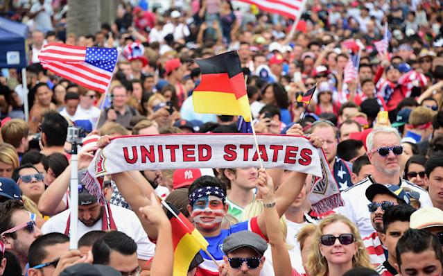 US fans show their support while watching the world cup match between the USA and Germany on a big screen at Hermosa Beach, California on June 26, 2014 (AFP Photo/Frederic J. Brown)