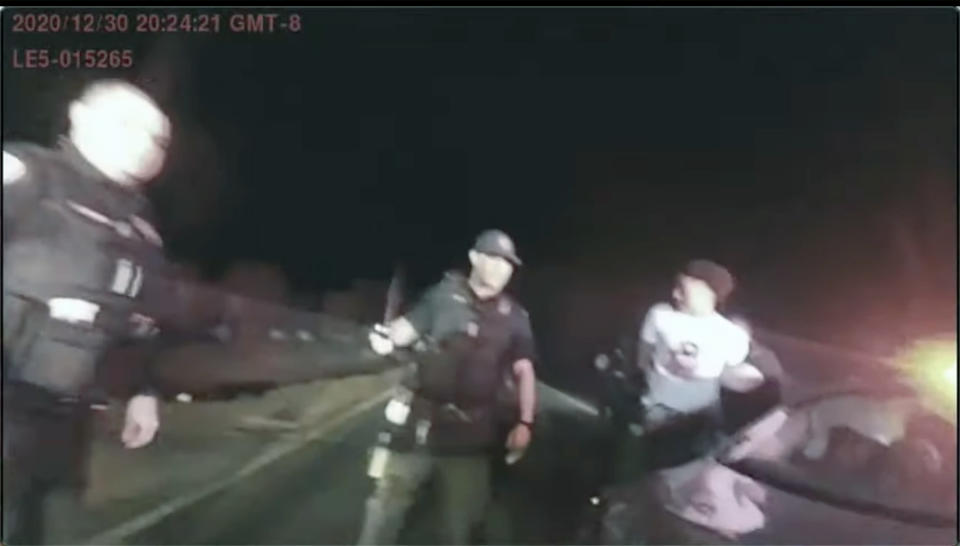 This Dec 31, 2020 photo provided by John L. Burris Law shows a still image from a Stockton Police Department body camera of the arrest of 17 year old Devin Carter. A grand jury in California has indicted two police officers on felony assault charges in the alleged beating of an unresisting Black teenager last year. The San Joaquin County district attorney announced the indictments against the two former Stockton police officers Friday Sept. 17, 2021. (Stockton Police Dept./John L. Burris Law via AP)