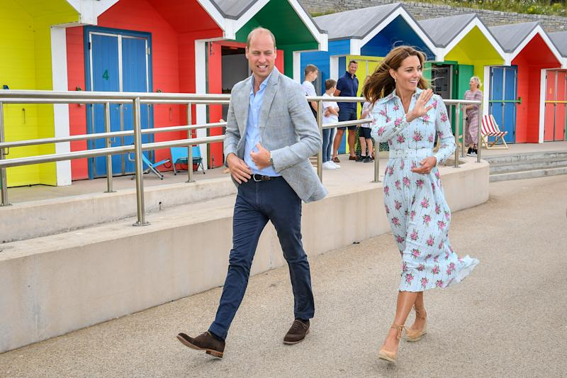 The Duke and Duchess of Cambridge wave to people on the beach as they leave the promenade after visiting beach huts, during their visit to Barry Island, South Wales, to speak to local business owners about the impact of COVID-19 on the tourism sector.