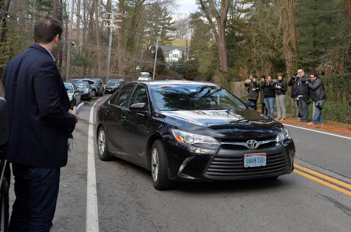 A vehicle with diplomatic license plates passes journalists after departing from a Russian compound in Upper Brookville, N.Y., Dec. 30, 2016. (Photo: Rashid Umar Abbasi/Reuters)