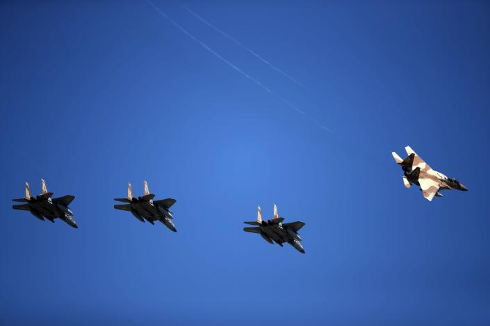 Israeli fighter jets F15 fly over Andravida air base, about 279 kilometres (174 miles) southwest of Athens, Tuesday, April 20, 2021. Greece vowed Tuesday to expand military cooperation with traditional NATO allies as well as Middle Eastern powers in a race to modernize its armed forces and face its militarily assertive neighbor Turkey. (AP Photo/Thanassis Stavrakis)