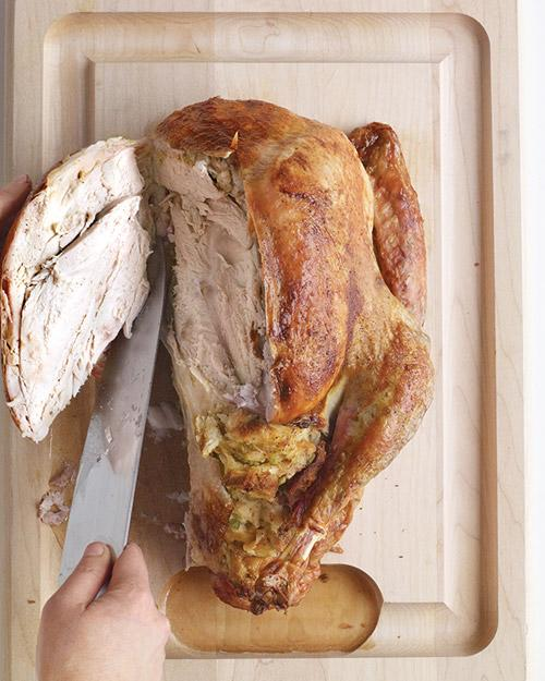 """<p>Cut the wings off at the joint and save them for gravy or <a href=""""https://www.marthastewart.com/336480/easy-turkey-stock"""">stock</a>. Then, remove the breasts: Keeping the blade close to the rib cage and using it as your guide, score the meat, tracing along both edges of the breast bone (otherwise known as the keel bone). You should then be able to peel both breasts away, using your hands. You'll have two torpedo-shaped pieces of white meat. Set them aside for now.</p>"""