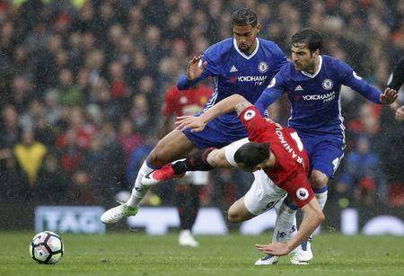 Britain Soccer Football - Manchester United v Chelsea - Premier League - Old Trafford - 16/4/17 Manchester United's Zlatan Ibrahimovic in action with Chelsea's Cesc Fabregas and Ruben Loftus-Cheek  Reuters / Phil Noble Livepic
