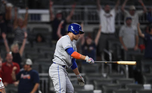 New York Mets' Michael Conforto strikes out on a pitch from Atlanta Braves' Jerry Blevins to end the baseball game Wednesday, Aug.14, 2019, in Atlanta. The Braves won 6-4. (AP Photo/John Amis)