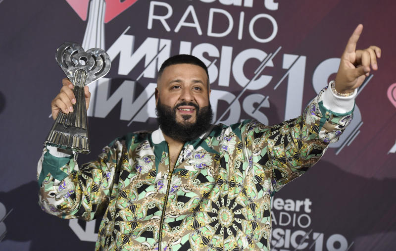 """FILE - In this March 11, 2018 file photo, DJ Khaled poses in the press room with the hip-hop song of the year award for """"Wild Thoughts"""" at the iHeartRadio Music Awards at The Forum in Inglewood, Calif. Demi Lovato celebrated six years sober at a concert in New York with tour mate and DJ Khaled, whose powerful brought the pop star to tears. Lovato performed Friday, March 16, 2018 at the Barclays Center in Brooklyn, New York, telling the audience March 15 was a proud day for her. (Photo by Jordan Strauss/Invision/AP, File)"""
