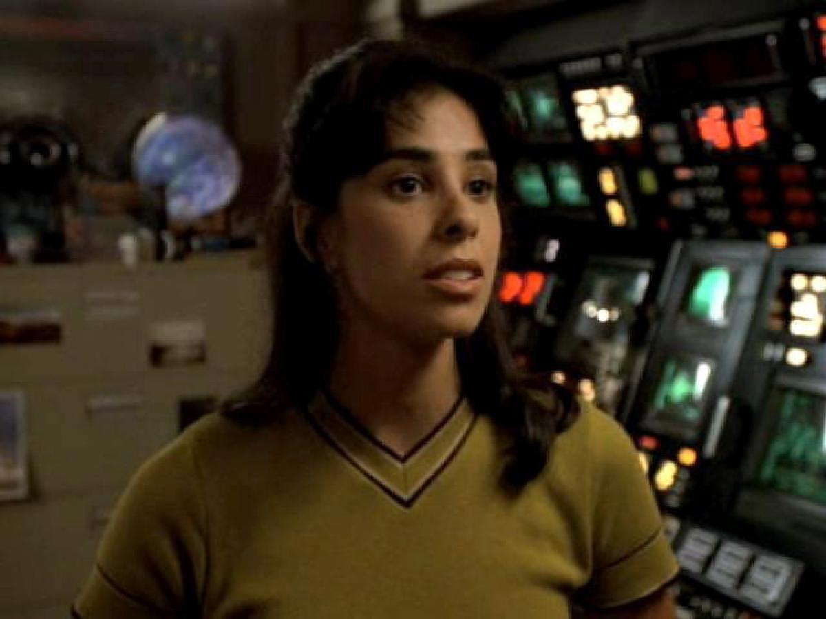 "<p>A decade after <em>Star Trek IV: The Voyage Home</em>, the crew of Voyager took their own trip back through the timestream in a 1996 two-part episode that set them down in '90s-era L.A. It's up to Silverman's earnest astronomer, Rain Robinson, to get them back to the future… and prevent a future apocalypse. <em>Trek</em> lore has it <a rel=""nofollow"" href=""https://ec.yimg.com/ec?url=http%3a%2f%2fwww.hollywoodreporter.com%2fheat-vision%2fstar-trek-iv-voyage-home-writer-eddie-murphys-lost-role-950551%26quot%3b%26gt%3bthat&t=1519331241&sig=I6CT6SjBVMkrjSg5HGSaAw--~D Richard Pryor very nearly starred</a> in <em>The Voyage Home</em>; landing Silverman early in her career was a great get for <em>Voyager</em>.<br /><br />(Photo: CBS) </p>"