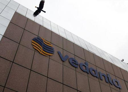 A bird flies by the Vedanta office building in Mumbai