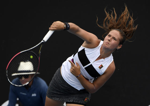 Russia's Daria Kasatkina serves to Switzerland's Timea Bacsinszky during their first round match at the Australian Open tennis championships in Melbourne, Australia, Tuesday, Jan. 15, 2019. (AP Photo/Andy Brownbill)
