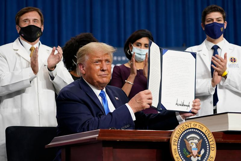 These pieces of paper won't make your health insurance, medical bills or prescription drugs any cheaper. (Photo: AP Photo/Evan Vucci)