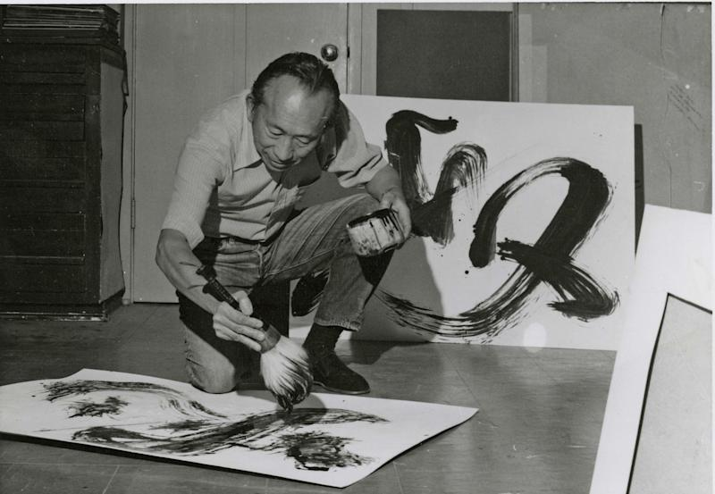 Tyrus Wong painting in his studio.
