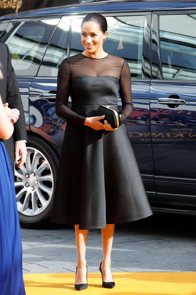 """<p>The duchess stunned in a black sheer <a href=""""https://www.farfetch.com/uk/shopping/women/jason-wu-collection-mesh-panel-flared-dress-item-13126350.aspx"""" target=""""_blank"""">Jason Wu dress</a>, Lorraine Schwartz earrings, and <a href=""""https://www.mytheresa.com/en-us/gucci-broadway-embellished-satin-clutch-1250826.html?"""" target=""""_blank"""">Gucci clutch</a> while attending the London premiere of Disney's <em>The Lion King</em> (where she and Harry later met up with Beyoncé and Jay-Z). </p>"""