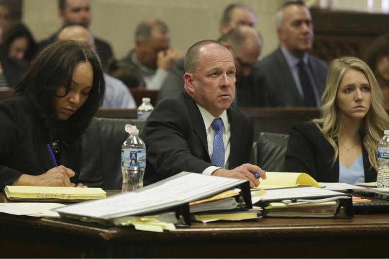 The prosecution team, from left, of Risa Lanier, John Maher and Anne Kelly listen to opening statements in Shomari Legghette's murder trial on Tuesday, March 3, 2020, at the Leighton Criminal Court Building in Chicago. Legghette's accused of killing Chicago police Cmdr. Paul Bauer on Feb. 13, 2018. (Stacey Wescott/Chicago Tribune via AP, Pool)