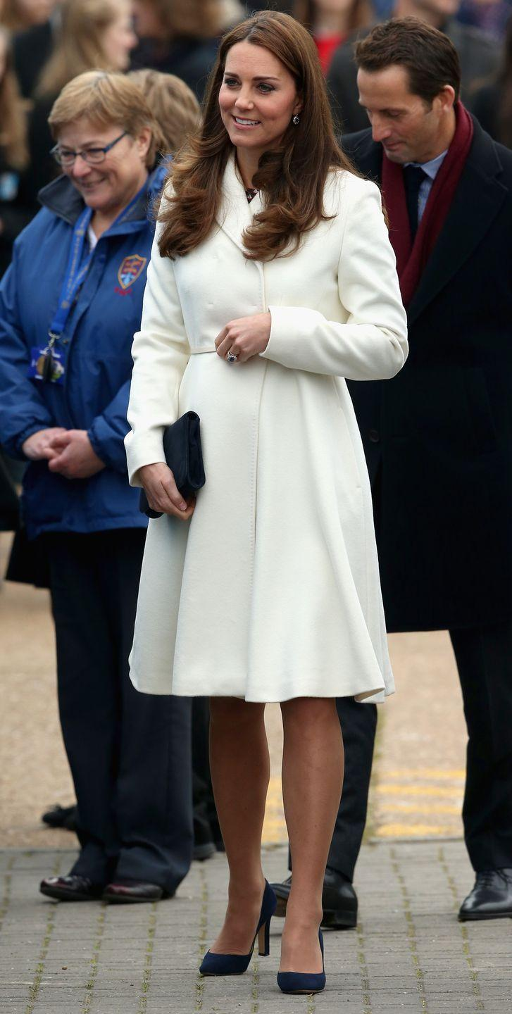 <p>Kate and Meghan both know how to rock winter white outerwear. Kate wore this chic MaxMara coat in 2015.</p>