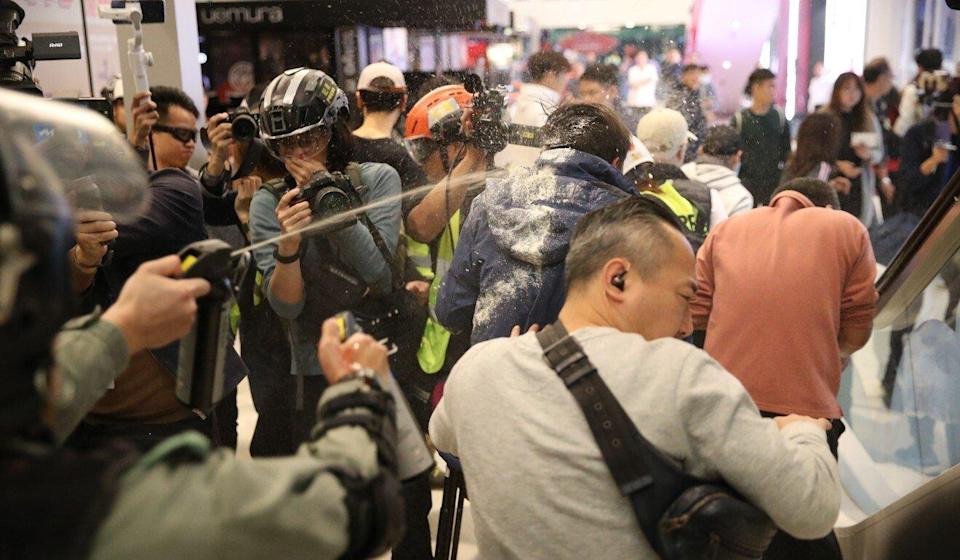 Police fire pepper spray while trying to detain a man inside Landmark North shopping centre. Photo: Winson Wong
