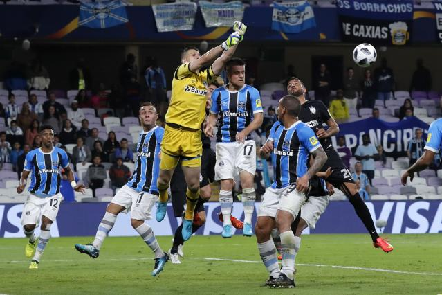 Mexico's Pachuca and Brazil's Gremio players jump for the ball during the Club World Cup semifinal soccer match between Gremio and Pachuca at the Hazza Bin Zayed stadium in Al Ain, United Arab Emirates, Tuesday, Dec. 12, 2017. Gremio won 1-0. (AP Photo/Hassan Ammar)