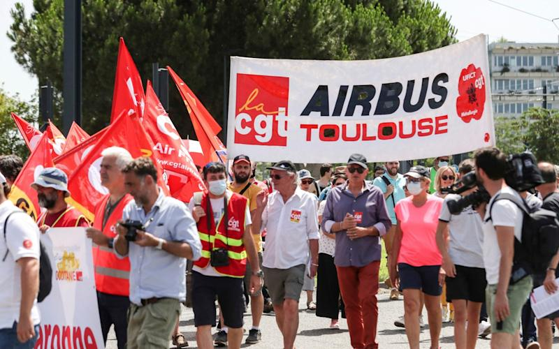 Protestors gather in Toulouse, south of France, Thursday, July 9, 2020, to demonstrate against European aircraft manufacturer Airbus planning to eliminate 15,000 jobs over the next year. The jobs will mostly be lost in Europe. Airbus is struggling with the financial hit of the coronavirus pandemic. - Manuel Blondeau/AP