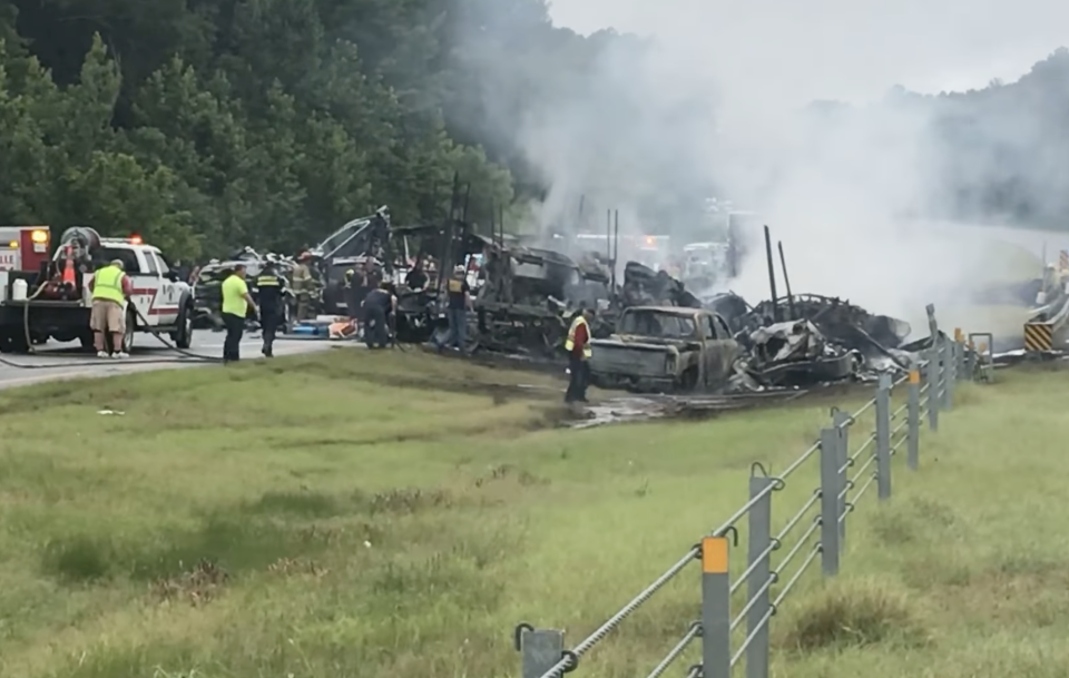 A smouldering 15-car pile up is pictured in Alabama.