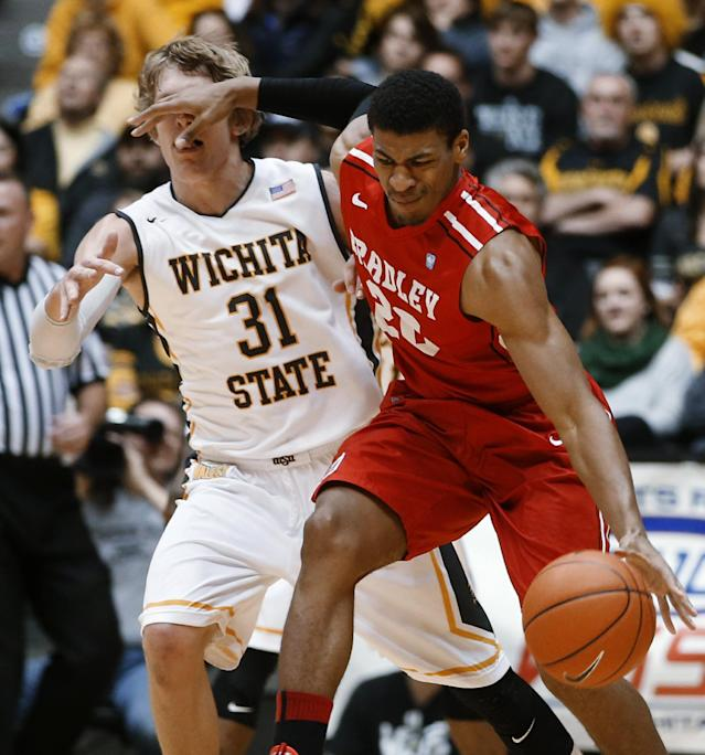 Wichita State's Ron Baker is fouled by Bradley's Tyshon Pickett during an NCAA college basketball game Tuesday, Jan. 14, 2014, in Wichita, Kan. (AP Photo/Wichita Eagle, Jaime Green)
