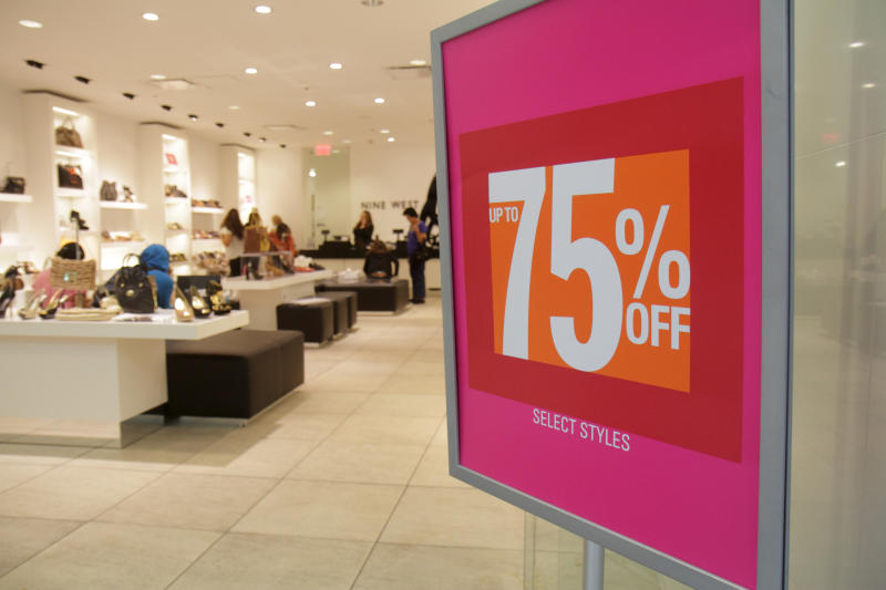 75% off sign in the entrance to Nine West. (Photo by: Jeffrey Greenberg/Universal Images Group via Getty Images)