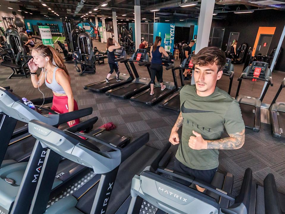 People using exercise machines at a PureGym site (PA Archive)