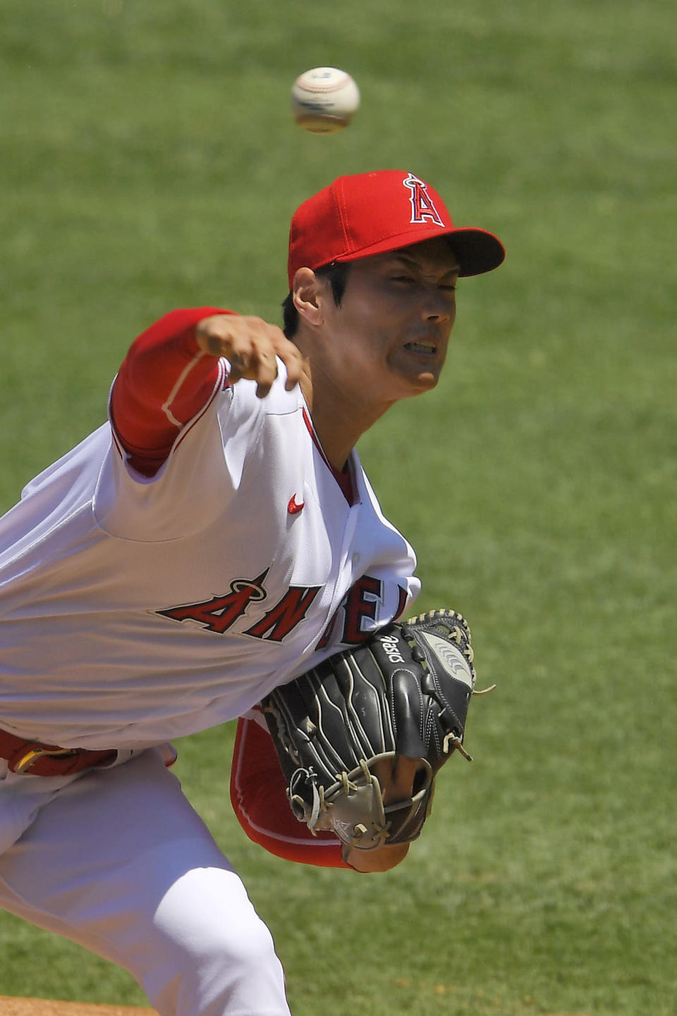 Los Angeles Angels designated hitter Shohei Ohtani, of Japan, throws to the plate during the first inning of a baseball game against the Houston Astros Sunday, Aug. 2, 2020, in Anaheim, Calif. (AP Photo/Mark J. Terrill)