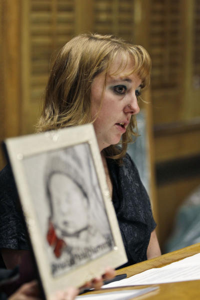 "In this Monday, Jan. 28, 2013 photo, Heather Surovik, who lost her 8 1/2-month-old unborn son when her car was struck by drunken driver Gary Sheats in 2012, speaks at a news conference promoting a political drive to grant ""personhood"" status to unborn fetuses at the Colorado State Capitol in Denver. Prosecutors could not file vehicular manslaughter charges because her unborn son was not legally a person. When a Catholic hospital in Colorado used the same argument to avoid a wrongful death lawsuit over twin fetuses that died in its care, it triggered an avalanche of criticism. (AP Photo/Brennan Linsley)"
