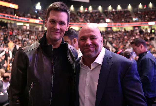 "UFC president Dana White (R), shown with <a class=""link rapid-noclick-resp"" href=""/nfl/teams/new-england/"" data-ylk=""slk:Patriots"">Patriots</a> quarterback <a class=""link rapid-noclick-resp"" href=""/nfl/players/5228/"" data-ylk=""slk:Tom Brady"">Tom Brady</a> at UFC 246 in January, said he'll ask the legendary quarterback about signing with the Raiders during an Instagram live stream on Wednesday at 3 p.m. ET. (Chris Unger/Getty Images)"