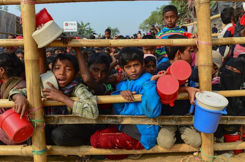 The bulk of the Rohingya in Bangladesh, or some 700,000 people, flooded across the border last August to escape the violence (AFP Photo/Munir UZ ZAMAN)