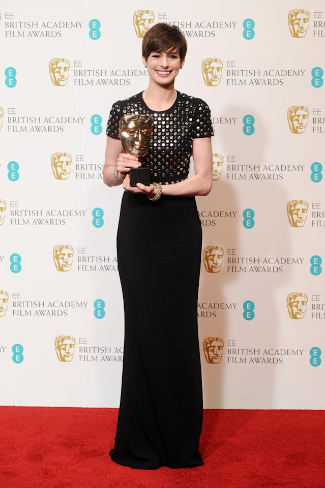 LONDON, ENGLAND - FEBRUARY 10:  Actress Anne Hathaway, winner of the Supporting Actress award poses in the press room at the EE British Academy Film Awards at The Royal Opera House on February 10, 2013 in London, England.  (Photo by Stuart Wilson/Getty Images)