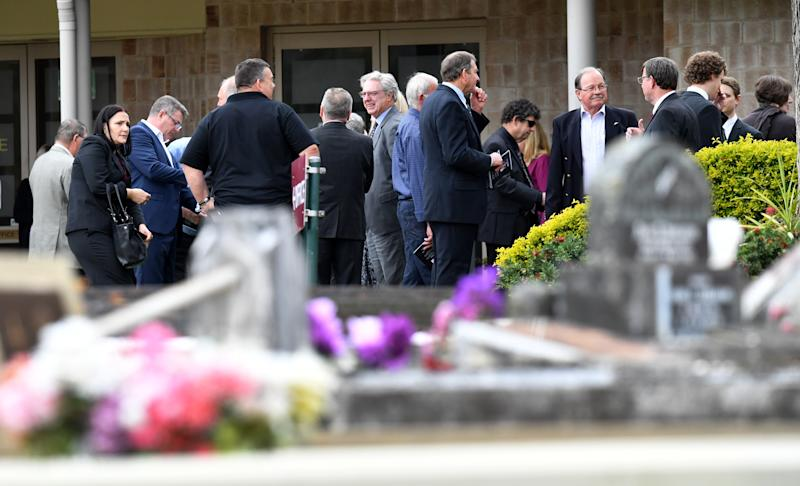 The family and friends are seen at the funeral service for Bernard Prendergast, Sarah Caisip's father, in Brisbane. Source: AAP