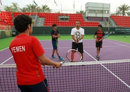Suhail Alsaeedi from Sanaa, Ammar Saeed from Aden, Alhassan Ishaq from Sanaa and their coach Osama al-Maqaleh take part in a training session at Khalifa International Tennis and Squash Complex in Doha, Qatar, March 2, 2017. REUTERS/Naseem Zeitoon