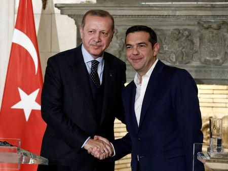 Greek Prime Minister Alexis Tsipras and Turkish President Tayyip Erdogan attend a press conference following their meeting at the Maximos Mansion in Athens, Greece December 7, 2017. REUTERS/Costas Baltas