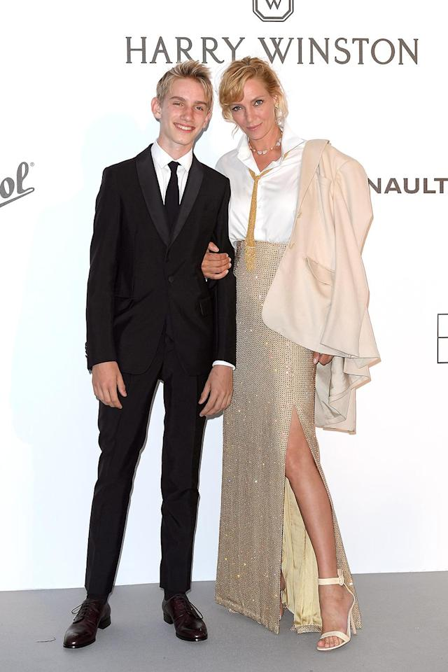 <p>Uma Thurman also hit up the amfAR Gala with a younger man on her arm: Her 15-year-old son, Levon Roan Thurman-Hawke. The <em>Kill Bill</em> actress dazzled in a gold skirt and white button-down shirt, while Levon (her son with ex-husband Ethan Hawke) looked handsome in his black suit. The kid's got good genes! (Photo: Dominique Charriau/WireImage) </p>