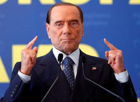 FILE PHOTO: Forza Italia leader Silvio Berlusconi gestures during EPP European People's Party meeting in Fiuggi