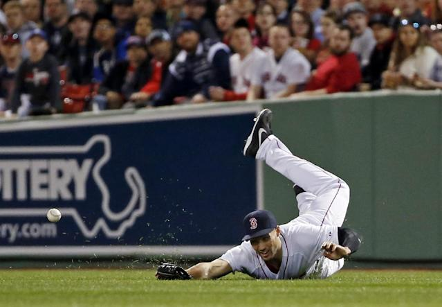 Boston Red Sox right fielder Grady Sizemore dives but cannot catch a single by New York Yankees' Brian Roberts during the third inning of a baseball game at Fenway Park in Boston, Tuesday, April 22, 2014. (AP Photo/Elise Amendola)