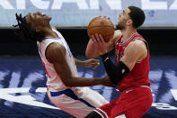 Los Angeles Clippers guard Terance Mann, left, is fouled by Chicago Bulls guard Zach LaVine during the second half of an NBA basketball game in Chicago, Friday, Feb. 12, 2021. (AP Photo/Nam Y. Huh)