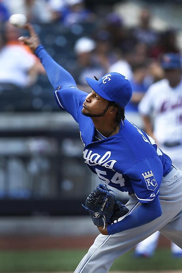 Kansas City Royals starting pitcher Ervin Santana throws the ball during the sixth inning of an interleague baseball game against the New York Mets at Citi Field, Sunday, Aug. 4, 2013, in New York. (AP Photo/John Minchillo)