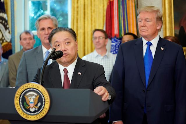 Hock E. Tan, CEO of Broadcom, speaks after U.S. President Donald Trump delivered remarks about the situation of the job market, in the Oval Office of the White House in Washington, U.S. November 2, 2017. REUTERS/Carlos Barria