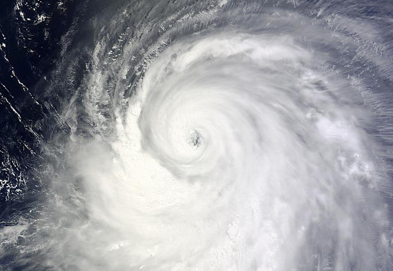 """A Moderate Resolution Imaging Spectroradiometer (MODIS) image from NASA's Terra satellite shows Typhoon Neoguri in the Pacific Ocean, approaching Japan on its northward journey July 6, 2014. Japan's weather agency on Monday issued emergency warnings to urge people in the country's southern islands to take maximum precautions as a super typhoon described as a """"once in decades storm"""" is set to rake the Okinawa island chain with heavy rain and powerful winds. Picture taken July 6, 2014. REUTERS/NASA/Handout via Reuters (JAPAN - Tags: DISASTER ENVIRONMENT) ATTENTION EDITORS - THIS PICTURE WAS PROVIDED BY A THIRD PARTY. REUTERS IS UNABLE TO INDEPENDENTLY VERIFY THE AUTHENTICITY, CONTENT, LOCATION OR DATE OF THIS IMAGE. FOR EDITORIAL USE ONLY. NOT FOR SALE FOR MARKETING OR ADVERTISING CAMPAIGNS. THIS PICTURE WAS PROCESSED BY REUTERS TO ENHANCE QUALITY. AN UNPROCESSED VERSION WILL BE PROVIDED SEPARATELY"""