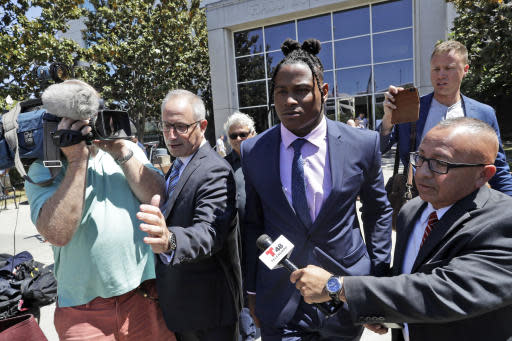 San Francisco 49ers linebacker Reuben Foster, center, leaves the Santa Clara County Superior Court, with his attorney Joshua Bentley, second from left, after a preliminary hearing stemming from domestic violence accusations against Foster, Thursday, May 17, 2018, in San Jose, Calif. Foster's ex-girlfriend, Elissa Ennis, recanted allegations Thursday that Foster physically assaulted her. She testified that she lied to authorities about the domestic assault to get back at Foster for breaking up with her. (AP Photo/Marcio Jose Sanchez)