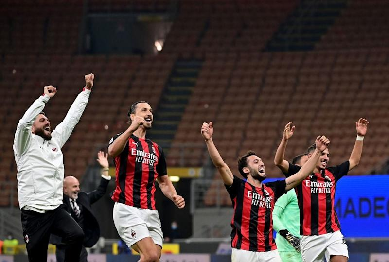 Milan celebrate their derby winAFP via Getty Images