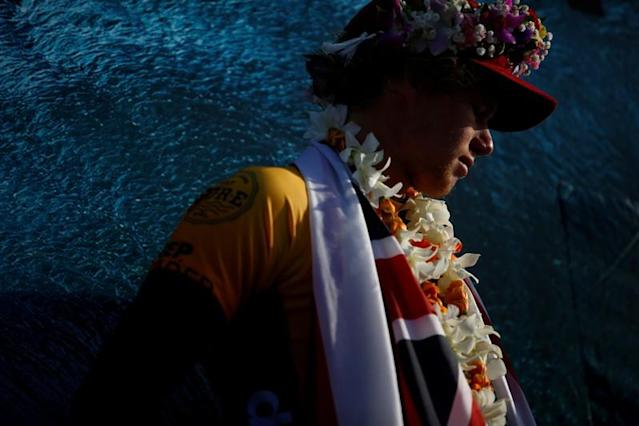 FILE PHOTO: World Champion John John Florence is seen at the end of competition at the Billabong Pipe Masters at the Banzai Pipeline in Pupukea on the island of Oahu