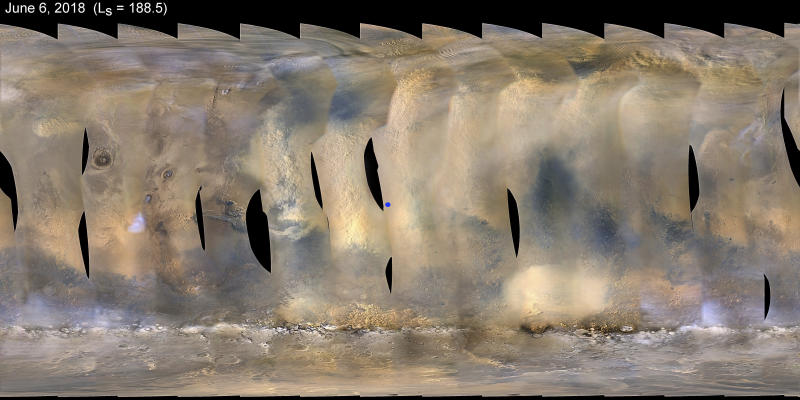 This composite image made from observations by NASA's Mars Reconnaissance Orbiter spacecraft shows a global map of Mars with a growing dust storm as of June 6, 2018. The storm was first detected on June 1. The blue dot at center indicates the approximate location of the Opportunity rover. (NASA/JPL-Caltech/MSSS via AP)