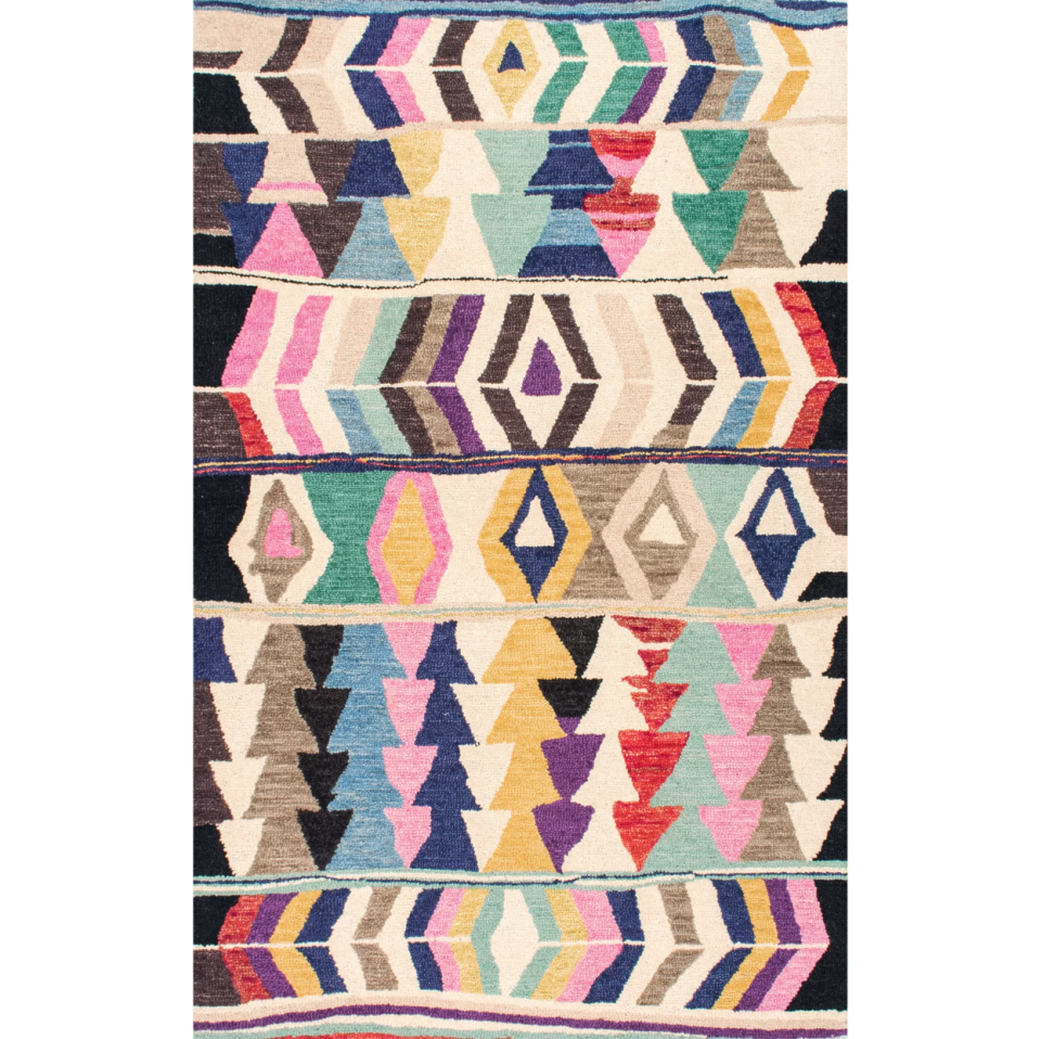 "<p>An eclectic pattern and soft wool weave makes this eye-catching rug feel like a pricey investment purchase.</p><br><br><strong>Bungalow Rose</strong> Foti Hand-Tufted Pink/Beige Area Rug, $142.99, available at <a href=""https://www.allmodern.com/rugs/pdp/bungalow-rose-foti-hand-tufted-pinkbeige-area-rug-bngl7314.html"" rel=""nofollow noopener"" target=""_blank"" data-ylk=""slk:AllModern"" class=""link rapid-noclick-resp"">AllModern</a>"