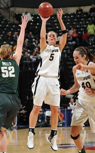 Purdue's Brittany Rayburn (5) shoots for 3 points over Michigan State's Becca Mills, left, during the first half of an NCAA college basketball game at the women's Big 10 tournament, Friday, March 2, 2012, in Indianapolis. (AP Photo/The Indianapolis Star, Matt Kryger) NO SALES