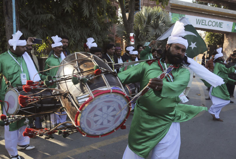 Pakistani drummers perform outside the Gadaffi Stadium ahead of the Pakistani Super League match in Lahore, Pakistan, Friday, Feb. 21, 2020. (AP PhotoK.M. Chaudhry)