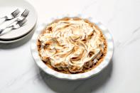 "A vanilla wafer crumb crust gives signature banana pudding flavor to this holiday pie. We like the toasted meringue topping, but if you're more of a whipped cream person, feel free to change it up. <a href=""https://www.epicurious.com/recipes/food/views/banana-pudding-custard-pie-smalls?mbid=synd_yahoo_rss"" rel=""nofollow noopener"" target=""_blank"" data-ylk=""slk:See recipe."" class=""link rapid-noclick-resp"">See recipe.</a>"