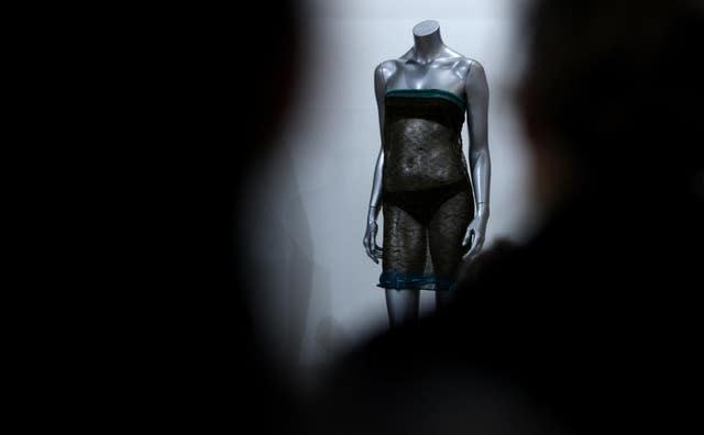 A transparent dress once worn by Kate Middleton at a charity fashion show at the University of St Andrews in 2002 which is thought to have been attended by William (Chris Radburn/PA)