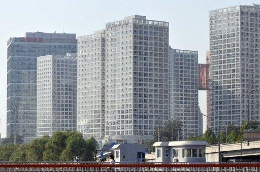 China says home prices rose in October